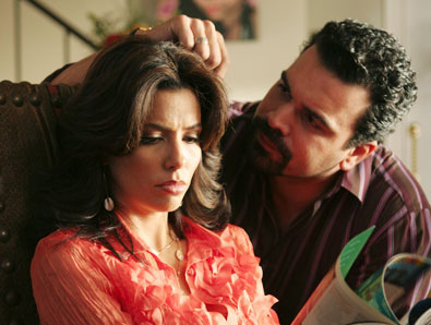 Eva Longoria-Parker as Gabby and Ricardo Antonio Chaviro as Carlos